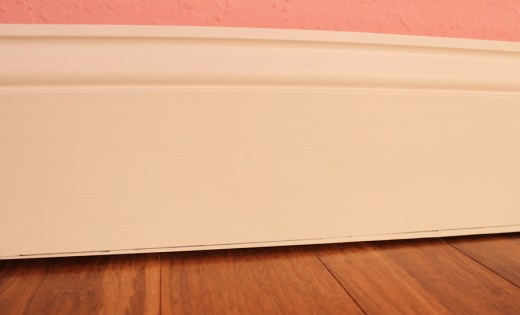 Install Baseboards Along Crooked Floors